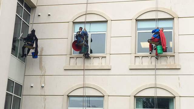 Superheroes Cleaning Windows At Sanford Children's Hospital